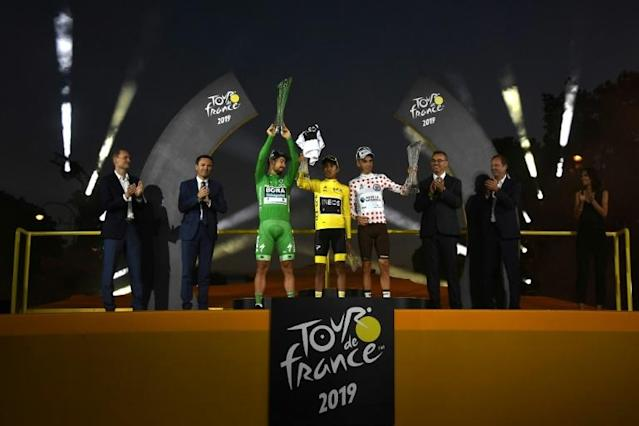 Peter Sagan in the sprinter's green jersey alongside the 2019 champion Egan Bernal in yellow and king of the mountains Romain Bardet in the polka dot jersey (AFP Photo/JEFF PACHOUD)