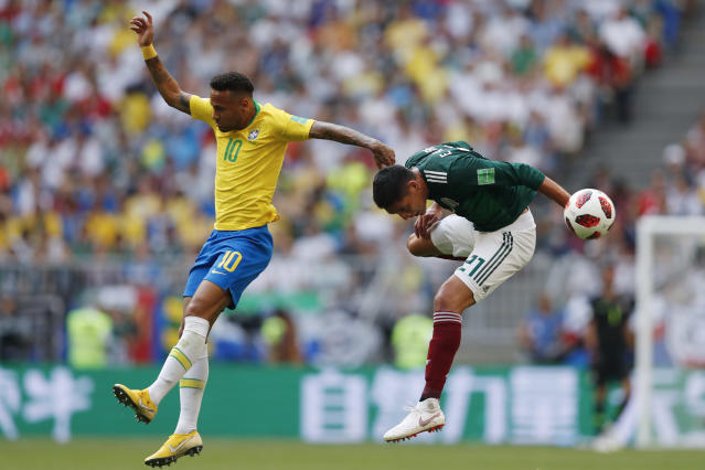 <p>Brazil's Neymar, left, and Mexico's Edson Alvarez go for a header during their round of 16 match at the 2018 soccer World Cup in the Samara Arena, in Samara, Russia, Monday, July 2, 2018. (AP Photo/Eduardo Verdugo) </p>
