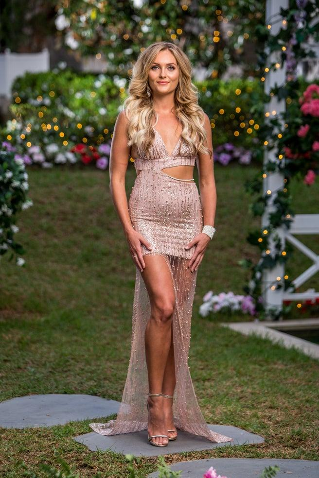 Nichole Wood in gold dress on Bachelor opening night