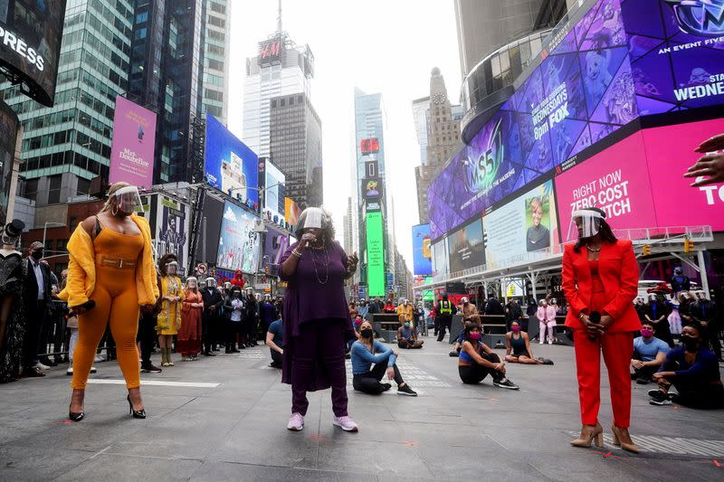Performers take part in a pop up Broadway performance in anticipation of Broadway reopening in New York City