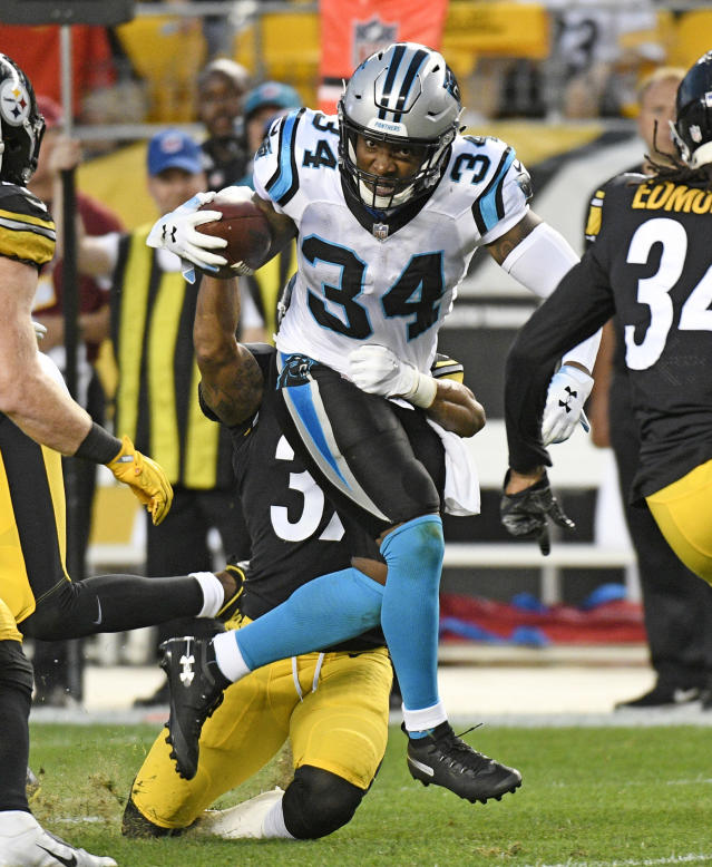 Carolina Panthers running back Cameron Artis-Payne (34) breaks a tackle by Pittsburgh Steelers defensive back Malik Golden (39) during the first half of a preseason NFL football game in Pittsburgh, Thursday, Aug. 30, 2018. (AP Photo/Don Wright)