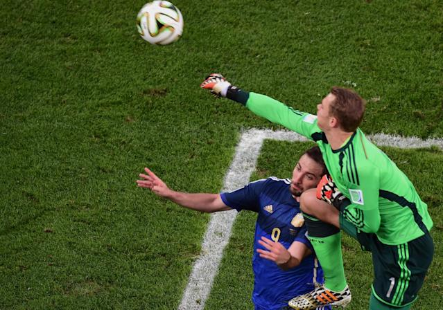 Germany's goalkeeper Manuel Neuer collides with Argentina's Gonzalo Higuain during the World Cup final soccer match between Germany and Argentina at the Maracana Stadium in Rio de Janeiro, Brazil, Sunday, July 13, 2014. (AP Photo/Francois Xavier Marit, Pool)