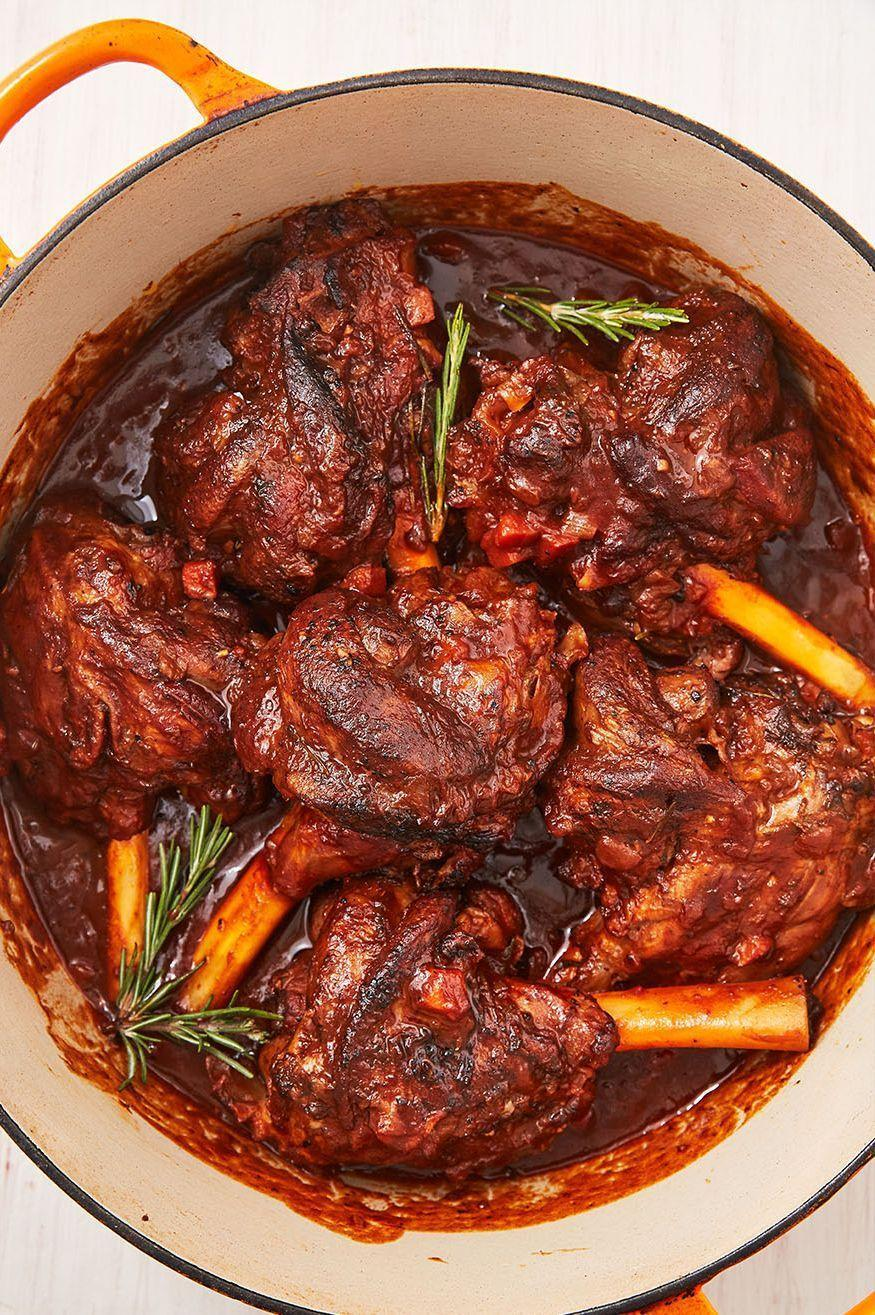 """<p>Braising <a href=""""https://www.delish.com/uk/cooking/recipes/a32152559/lamb-burger-recipe/"""" rel=""""nofollow noopener"""" target=""""_blank"""" data-ylk=""""slk:lamb"""" class=""""link rapid-noclick-resp"""">lamb</a> shanks might sound a little intimidating, but honestly, it couldn't be easier. After a quick sear, the oven does all the work for you! Lamb shanks can tend to be a tougher cut of meat so to get tender, fall off the bone lamb, it works best to cook them low and slow. They'll braise in a savoury tomato sauce that gives the meat so much flavor and the sauce becomes extra silky after the wine and butter gets stirred in. You'll have the most comforting dinner you've had all year! </p><p>Get the <a href=""""https://www.delish.com/uk/cooking/recipes/a32327534/braised-lamb-shank-recipe/"""" rel=""""nofollow noopener"""" target=""""_blank"""" data-ylk=""""slk:Braised Lamb Shanks"""" class=""""link rapid-noclick-resp"""">Braised Lamb Shanks</a> recipe.</p>"""