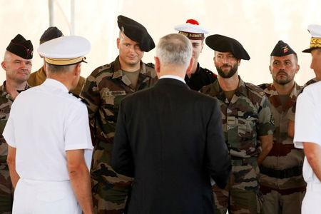 U.S. Defense Secretary James Mattis (C, back to camera) meets a detachment of French troops and sailors at Camp Lemonnier in Ambouli, Djibouti April 23, 2017. REUTERS/Jonathan Ernst