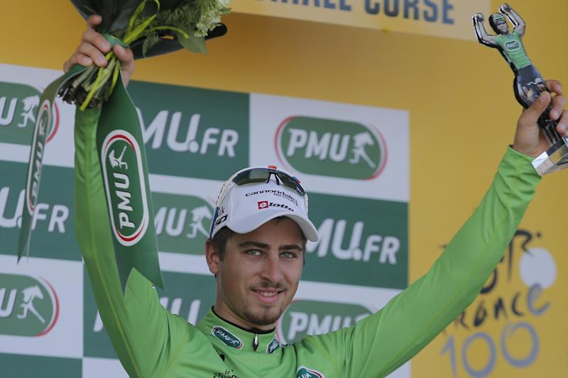 Peter Sagan of Slovakia, wearing the best sprinter's green jersey, celebrates on the podium of the third stage of the Tour de France cycling race over 145.5 kilometers (91 miles) with start in Ajaccio and finish in Calvi, Corsica island, France, Monday July 1, 2013. (AP Photo/Christophe Ena)