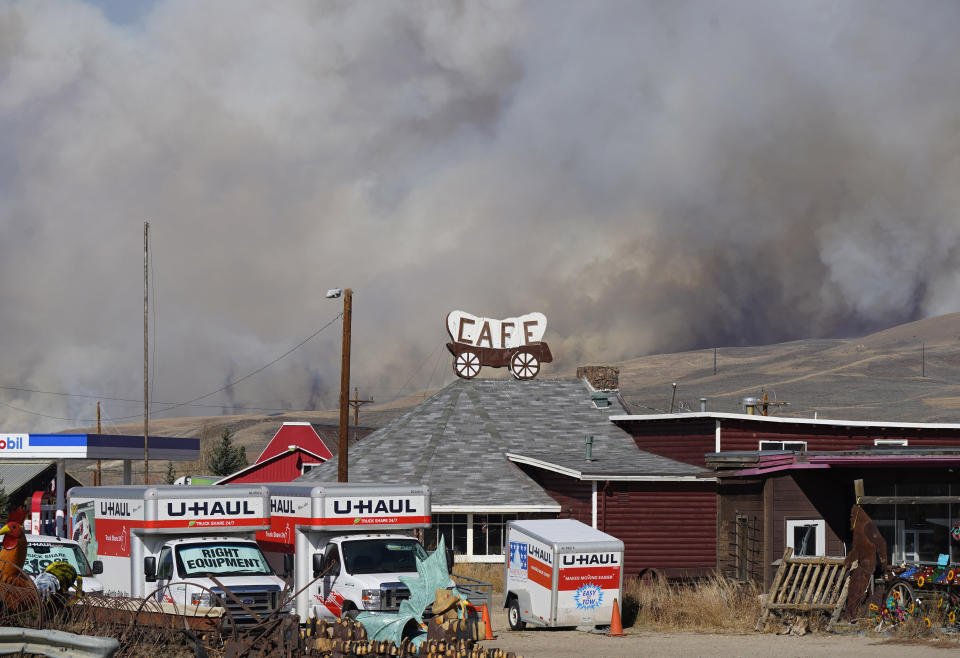 Smoke rises from mountain ridges as a wildfire burns south of Highway 34 Thursday, Oct. 22, 2020, near Granby, Colo. (AP Photo/David Zalubowski)