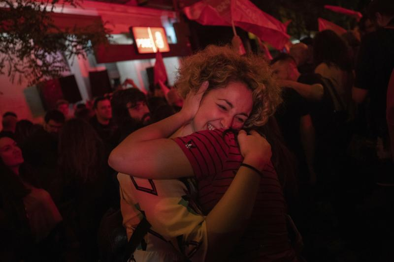 Spain's Socialist Party supporters celebrate outside the party headquarters following the general election in Madrid, Spain, Sunday, April 28, 2019. Spain's governing center-left Socialists won the country's election Sunday but must seek backing from smaller parties to maintain power, while a far-right party rode an unprecedented surge of support to enter the lower house of parliament for the first time in four decades. (AP Photo/Bernat Armangue)