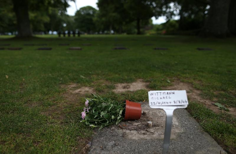 A pot of flowers at the grave of German SS officer Michael Wittmann at the German war cemetery in La Cambe, France on July 28, 2015
