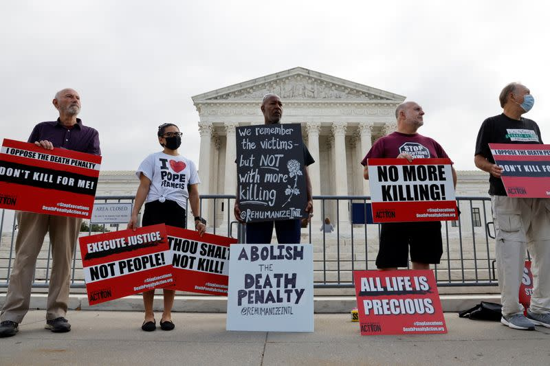 Demonstrators rally against the death penalty at the U.S. Supreme Court during arguments in the Tsarnaev case in Washington