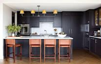 """<p>We love to see dark, rich colors in the fall, and these inky cabinets in an <a href=""""https://www.elledecor.com/design-decorate/house-interiors/a36879189/kevin-dumais-upper-west-side-apartment/"""" rel=""""nofollow noopener"""" target=""""_blank"""" data-ylk=""""slk:Upper West Side apartment designed by Kevin Dumais"""" class=""""link rapid-noclick-resp"""">Upper West Side apartment designed by Kevin Dumais</a> go perfectly with the kitchen's white backsplash. </p>"""