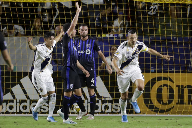 LA Galaxy forward Zlatan Ibrahimovic, right, celebrates after scoring against the Montreal Impact during the first half of an MLS soccer match in Carson, Calif., Saturday, Sept. 21, 2019. (AP Photo/Chris Carlson)