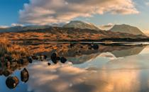 <p>Clouds reflect on Lochan na h-Achlaise in the Scottish West Highlands.</p>