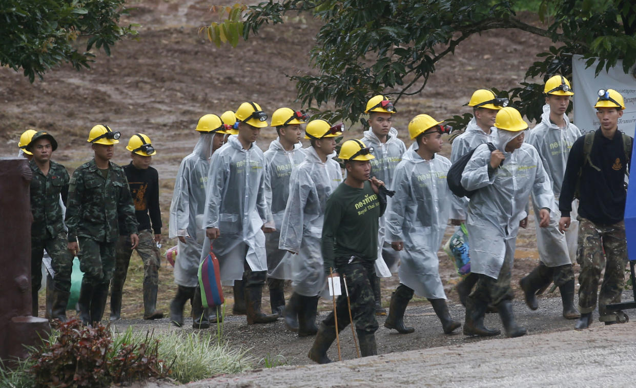 <em>Rescue – the rescuers had to get the boys out of a flooded cave complex where they had been trapped for two weeks (Picture: AP)</em>