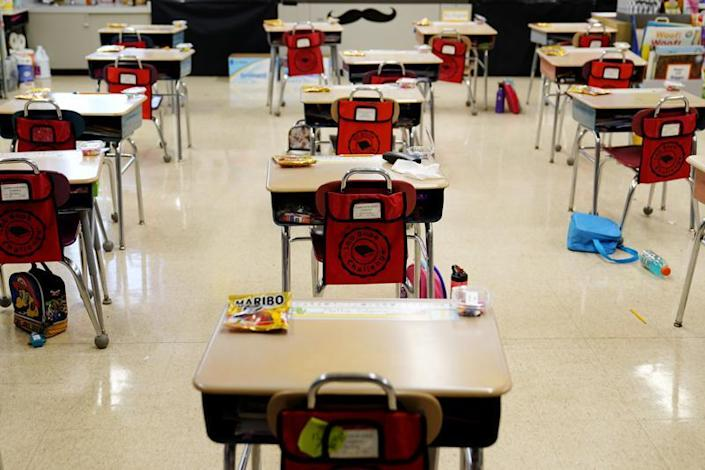 In this Thursday, March 11, 2021 file photo, desks are arranged in a classroom at an elementary school in Nesquehoning, Pa. (AP Photo/Matt Slocum, File)