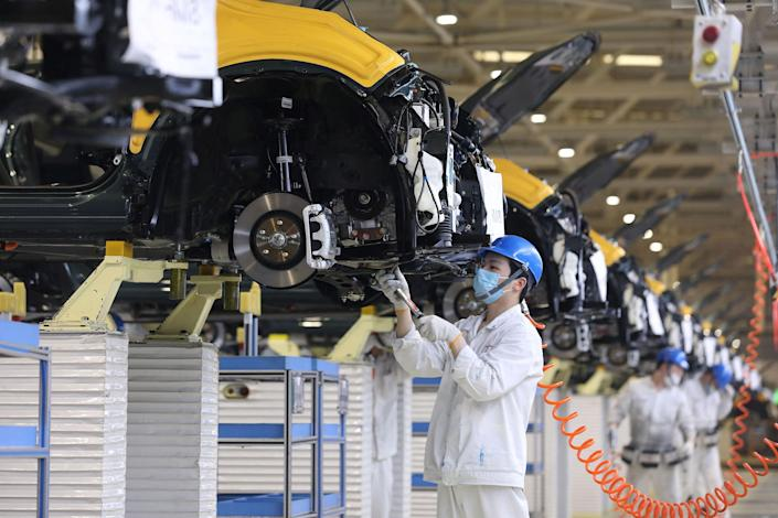 Image: An employee working on an assembly line at an auto plant of Dongfeng Honda in Wuhan in China's central Hubei province (AFP - Getty Images)
