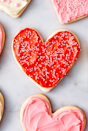 """<p>What could be sweeter than baking the cutest heart shaped cookies for someone special? We choose to make a cream cheese frosting for the cookies to make them extra special. And feel free to dye the frosting any colours you wish or use any sprinkles your heart desires! Perfectly customisable making them the perfect gift-able treat.</p><p>Get the <a href=""""https://www.delish.com/uk/cooking/recipes/a28829833/heart-shaped-cookies/"""" rel=""""nofollow noopener"""" target=""""_blank"""" data-ylk=""""slk:Heart Shaped Cookies"""" class=""""link rapid-noclick-resp"""">Heart Shaped Cookies</a> recipe.</p>"""