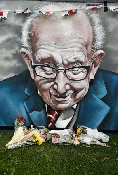 PHOTO: Flowers lie along a mural of late record-breaking centenarian Captain Tom Moore, who died on Feb. 2, 2021, in Two Gates, Tamworth, Britain Feb. 3, 2021. (Jason Cairnduff/Reuters)