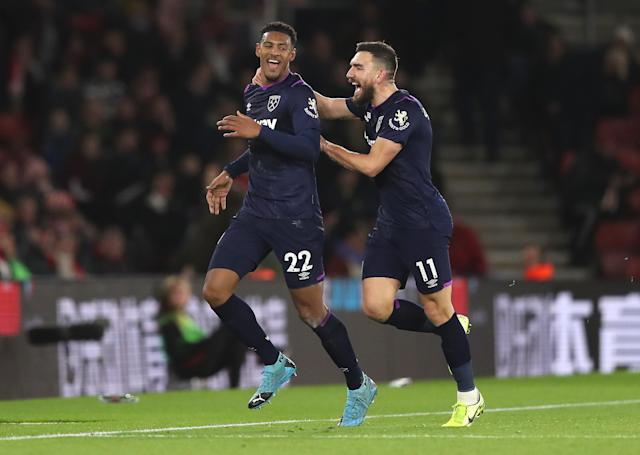 Sebastien Haller of West Ham United celebrates with teammate Robert Snodgrass. (Credit: Getty Images)