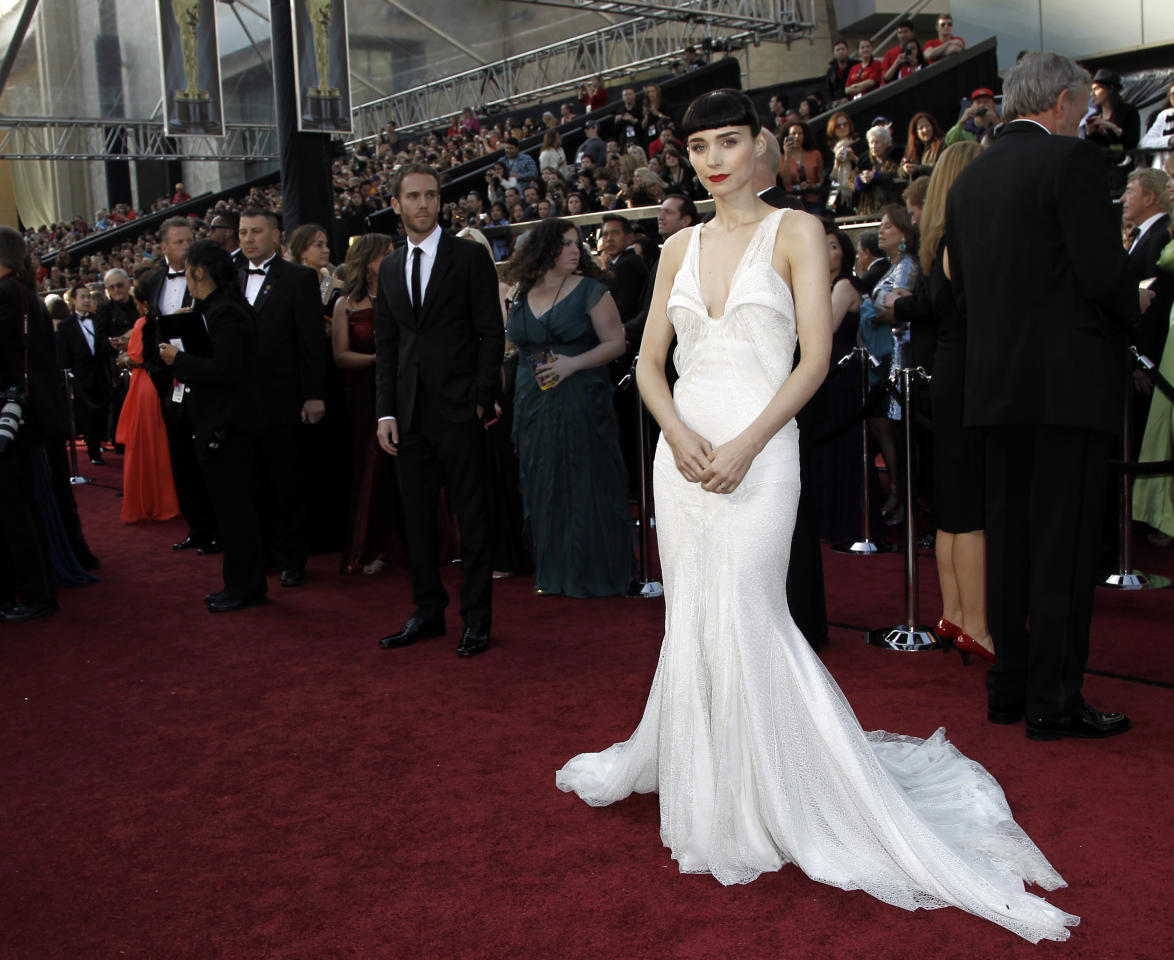 Rooney Mara arrives before the 84th Academy Awards on Sunday, Feb. 26, 2012, in the Hollywood section of Los Angeles. (AP Photo/Matt Sayles)