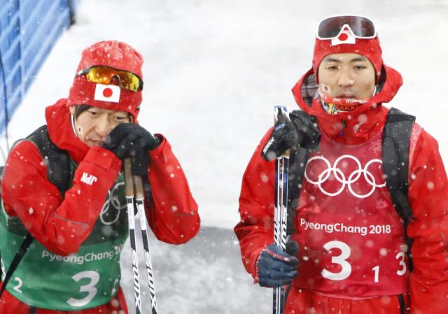 Nordic Combined Events - Pyeongchang 2018 Winter Olympics - Men's Team 4 x 5 km Final - Alpensia Cross-Country Skiing Centre - Pyeongchang, South Korea - February 22, 2018 - Yoshito Watabe and Hideaki Nagai of Japan react. REUTERS/Dominic Ebenbichler