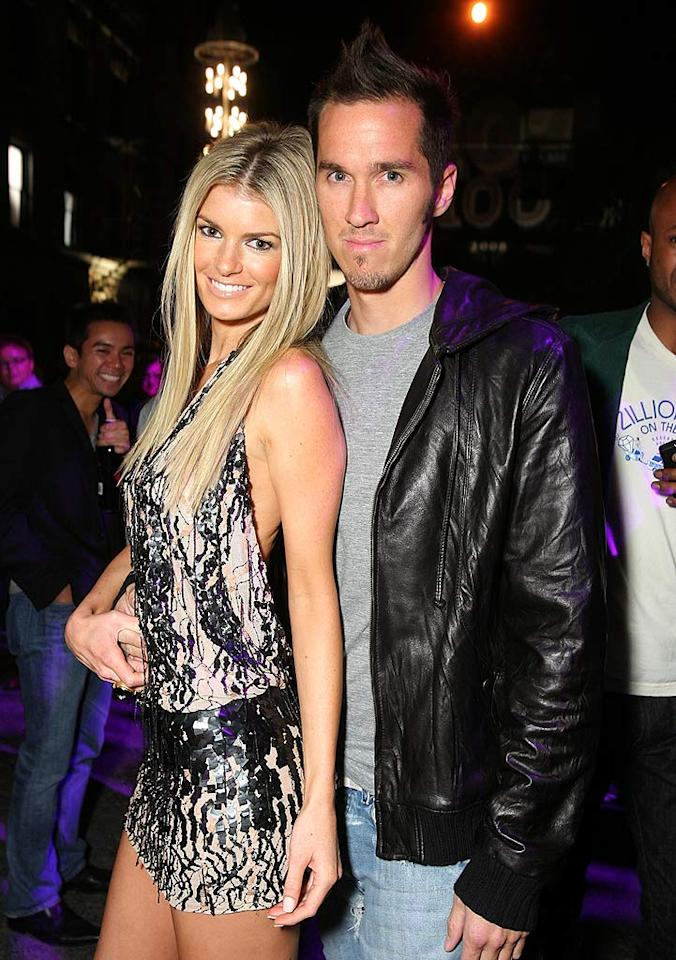 "Model Marisa Miller, who tops Maxim's Hot 100 list, and her beau Griffin Guess cozy up on the dance floor. Alexandra Wyman/<a href=""http://www.wireimage.com"" target=""new"">WireImage.com</a> - May 21, 2008"