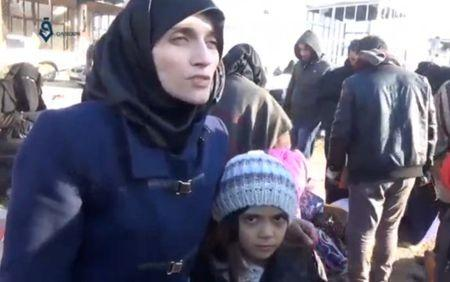 A still image taken on December 19, 2016 from a video posted on social media, shows Syrian girl who tweeted from Aleppo, Bana Alabed, standing with her mother, Fatemah Alabed, at what is said to be al-Rashideen