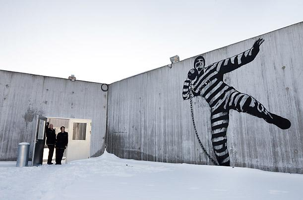 "To ease the psychological burdens of imprisonment, the planners at Halden spent roughly $1 million on paintings, photography and light installations. According to a prison informational pamphlet, this mural by Norwegian graffiti artist Dolk ""brings a touch of humor to a rather controlled space."" Officials hope the art — along with creative outlets like drawing classes and wood workshops — will give inmates ""a sense of being taken seriously."" Photo taken 2010. Credit: Trond Isaksen / Statsbygg"