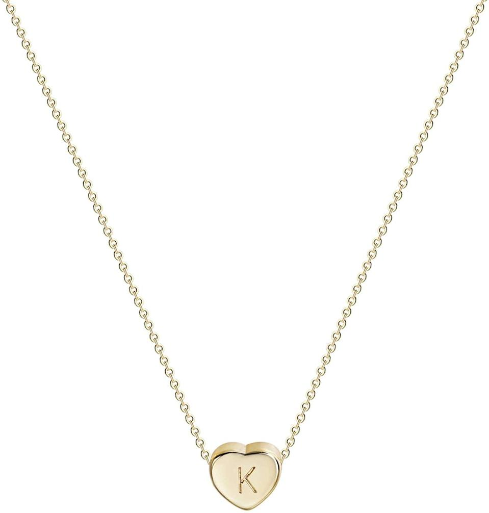 <p>The <span>Tiny Gold Initial Heart Necklace</span> ($14, originally $20) is heartfelt gift.</p>