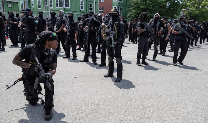 The Not F***ing Around Coalition came to Louisville in support of racial justice while the Three Percenters militia also was in town. Louisville police kept the two groups apart with barricades. The NFAC paused to look for snipers on their march to Jefferson Square for a rally. July 25, 2020.