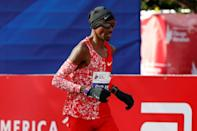 2018 winner Mo Farah crosses the Chicago Marathon finish line a distant eighth behind winner Lawrence Cherono of Kenya (AFP Photo/KAMIL KRZACZYNSKI)
