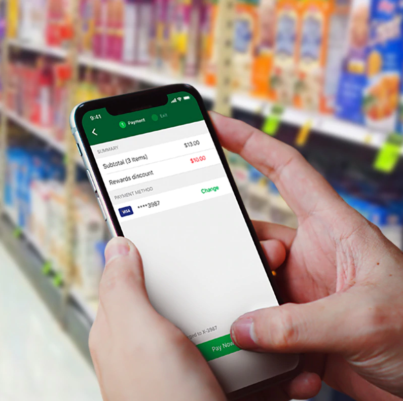 A person making a payment on the Scan&Go app on a smartphone.