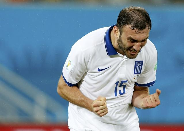 Greece's Vasilis Torosidis reacts after failing to score during their 2014 World Cup Group C soccer match against Japan at the Dunas arena in Natal June 19, 2014. REUTERS/Toru Hanai (BRAZIL - Tags: SOCCER SPORT WORLD CUP)
