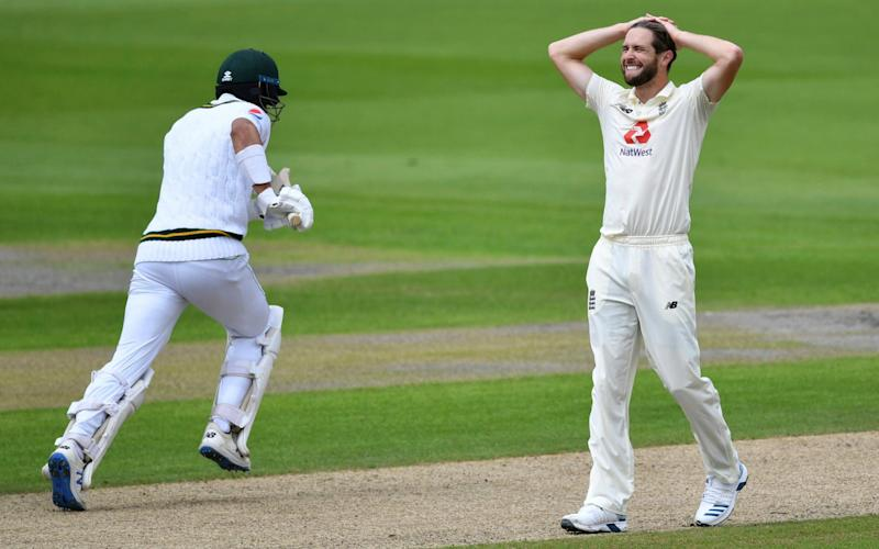 England's Chris Woakes, right, reacts after bowling a delivery to Pakistan's Shan Masood - getty images