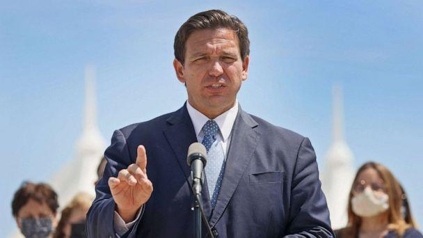 PHOTO: Florida Gov. Ron DeSantis speaks to the media about the cruise industry during a press conference at PortMiami on April 8, 2021 in Miami. The Governor announced that the state is suing the federal government to allow cruises to resume in Florida. (Joe Raedle/Getty Images, FILE)