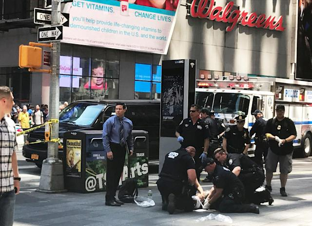 <p>First responders are assisting injured pedestrians after a vehicle struck pedestrians on a sidewalk in Times Square in New York on May 18, 2017. (REUTERS/Jeremy Schultz) </p>
