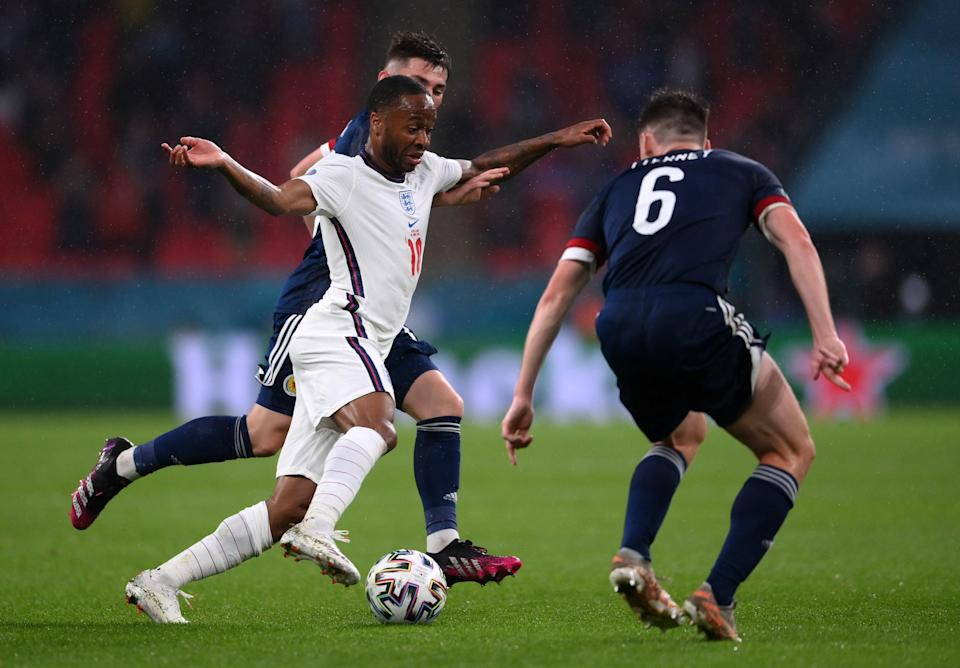 Raheem Sterling runs with the ball whilst under pressure from Kieran Tierney (Getty)