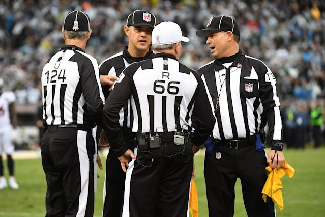 <p>Officials confer after a fight between Michael Crabtree #15 of the Oakland Raiders and Aqib Talib #21 of the Denver Broncos during their NFL game at Oakland-Alameda County Coliseum on November 26, 2017 in Oakland, California. Both players were ejected from the game. (Photo by Robert Reiners/Getty Images) </p>