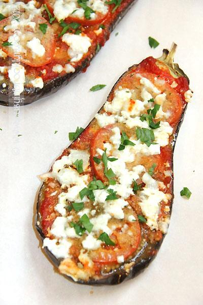 """Photo: Busy in Brooklyn<br> Roasted Eggplant Parmesan with Feta<br><br> We love smart adaptations of classics like this: instead of frying slices of eggplant, Busy in Brooklyn keeps them whole, and rather than blanketing them with mozzarella and parmesan, keeps things light with a sprinkling of salty feta.<br><br> <b>Recipe: <a href=""""http://www.busyinbrooklyn.com/roasted-eggplant-parmesan-with-feta/"""" rel=""""nofollow noopener"""" target=""""_blank"""" data-ylk=""""slk:Roasted Eggplant Parmesan with Feta"""" class=""""link rapid-noclick-resp"""">Roasted Eggplant Parmesan with Feta</a></b>"""