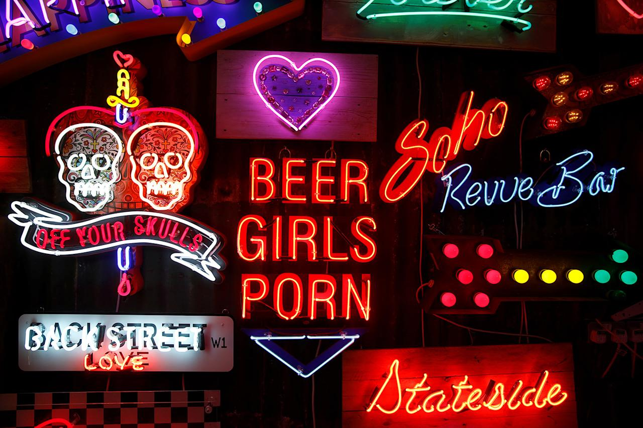 <p>Neon signs that read 'Off Your Skulls', 'Back Street Love', 'Soho Revue Bar', 'Beer Girls Porn' and 'Stateside' are exhibited in God's Own Junkyard gallery and cafe in London, Britain, March 31, 2017. (Photo: Russell Boyce/Reuters) </p>