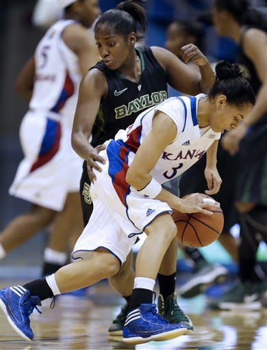 Kansas guard Angel Goodrich (3) is covered by Baylor guard Kimetria Hayden (1) during the first half of an NCAA college basketball game in Lawrence, Kan., Sunday, Jan. 13, 2013. (AP Photo/Orlin Wagner)