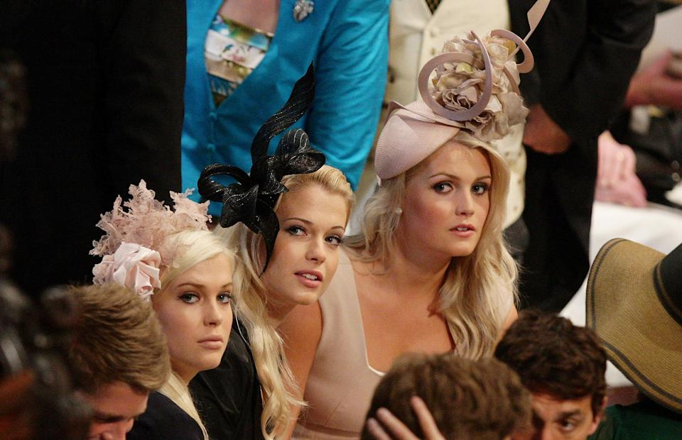 LONDON, ENGLAND - APRIL 29: Earl Spencer's daughter's (L-R) Lady Amelia, Lady Eliza and Lady Kitty sit together inside  Westminster Abbey ahead of the Royal Wedding of Prince William to Catherine Middleton at Westminster Abbey on April 29, 2011 in London, England. The marriage of the second in line to the British throne is to be led by the Archbishop of Canterbury and will be attended by 1900 guests, including foreign Royal family members and heads of state. Thousands of well-wishers from around the world have also flocked to London to witness the spectacle and pageantry of the Royal Wedding.  (Photo by Dave Thompson - WPA Pool/Getty Images)