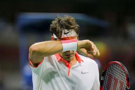 Roger Federer of Switzerland reacts after losing a point against Novak Djokovic of Serbia during their men's singles final match at the U.S. Open Championships tennis tournament in New York, September 13, 2015. REUTERS/Eduardo Munoz