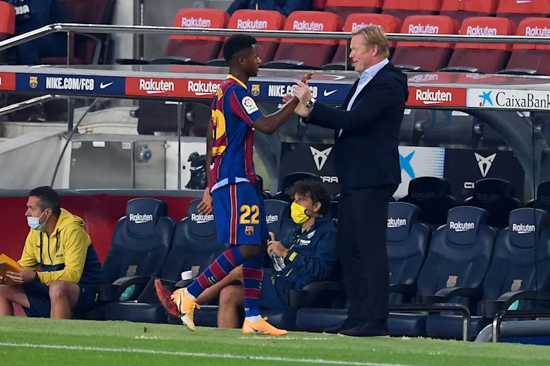 Barcelona's Dutch coach Ronald Koeman (R) greets Barcelona's Spanish forward Ansu Fati during the Spanish league football match FC Barcelona against Villarreal CF at the Camp Nou stadium in Barcelona on September 27, 2020. (Photo by Josep LAGO / AFP) (Photo by JOSEP LAGO/AFP via Getty Images)