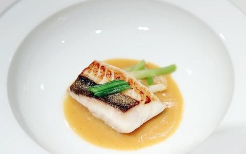 Served along with the Swiss speciality will be baked John Dory, from a flat sea fish remininscent of Mr Moon's port city hometown of Busan - Credit: AFP