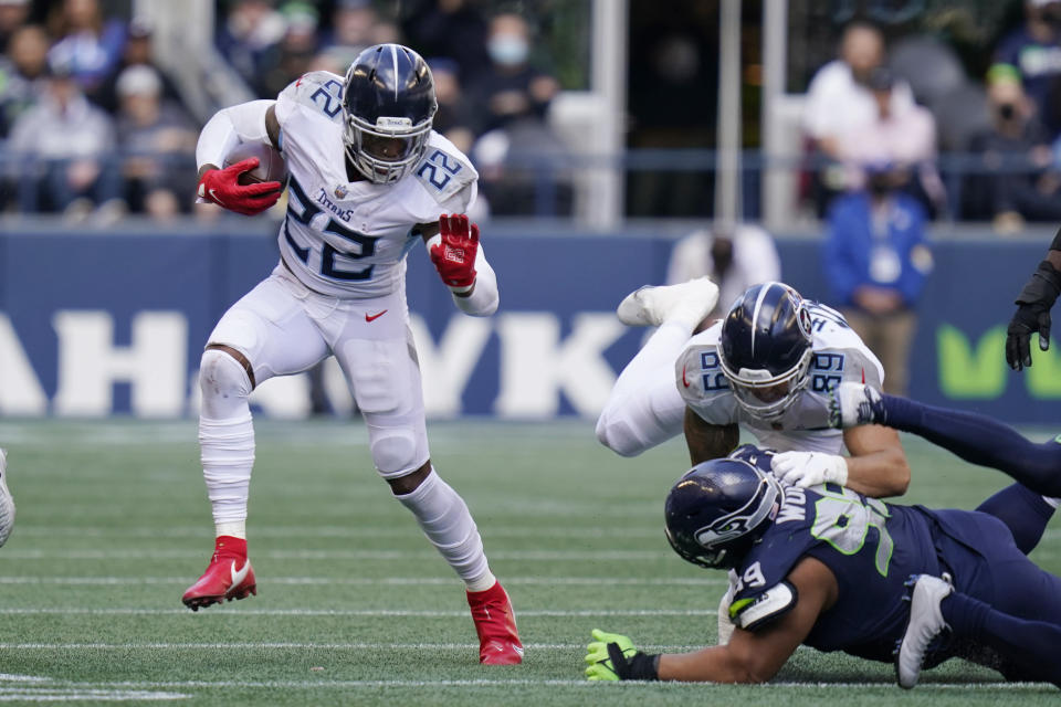 Tennessee Titans running back Derrick Henry (22) rushes against the Seattle Seahawks during the second half of an NFL football game, Sunday, Sept. 19, 2021, in Seattle. (AP Photo/Elaine Thompson)