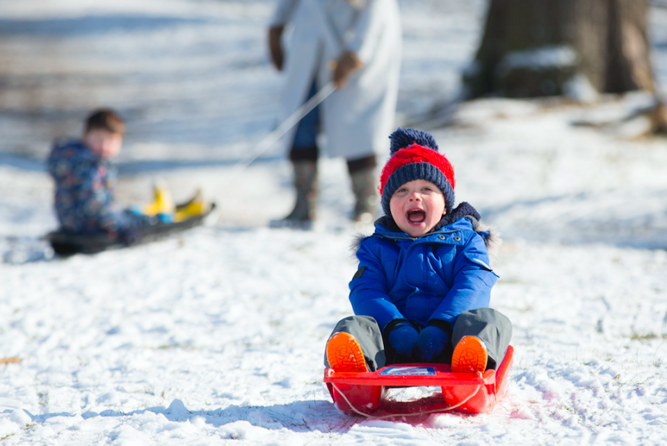 <em>Three-year-old Wilfred Martin, enjoys sledding in the snow in Richmond Park, London (PA)</em>