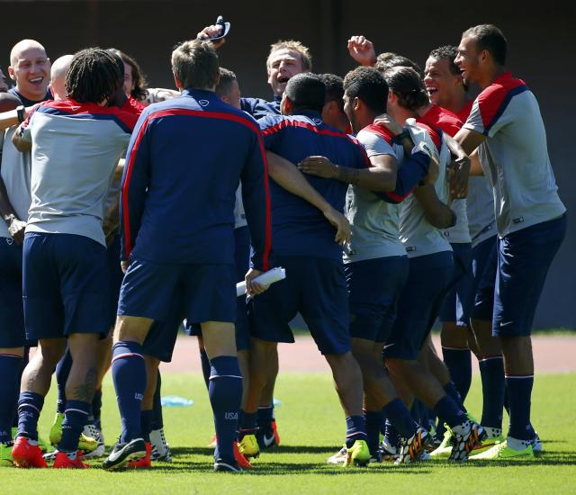 U.S. national soccer team coach Juergen Klinsmann (C) jokes with his players during a training session ahead of their 2014 World Cup round of 16 match against Belgium in Salvador, June 30, 2014. REUTERS/Michael Dalder (BRAZIL - Tags: SOCCER SPORT WORLD CUP)