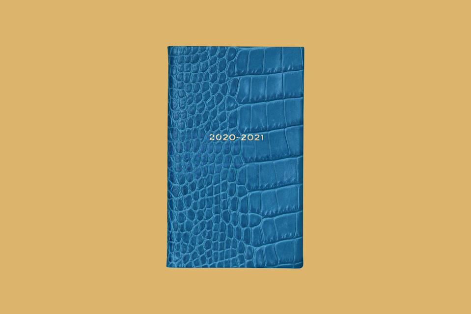 """<p>Perfect as a first-day-of-senior-year gift (or a gift for yourself), this planner's rich hue and compact make are just a few of its best qualities.</p> <p><strong><em>Shop Now:</em></strong><em> Smythson 2020/21 Mid-Year """"Panama"""" Agenda with Pocket, $110, <a href=""""https://www.smythson.com/us/azure-2020/21-mid-year-panama-agenda-with-pocket-1026092.html?cgid=326"""" rel=""""nofollow noopener"""" target=""""_blank"""" data-ylk=""""slk:smythson.com"""" class=""""link rapid-noclick-resp"""">smythson.com</a>.</em></p>"""