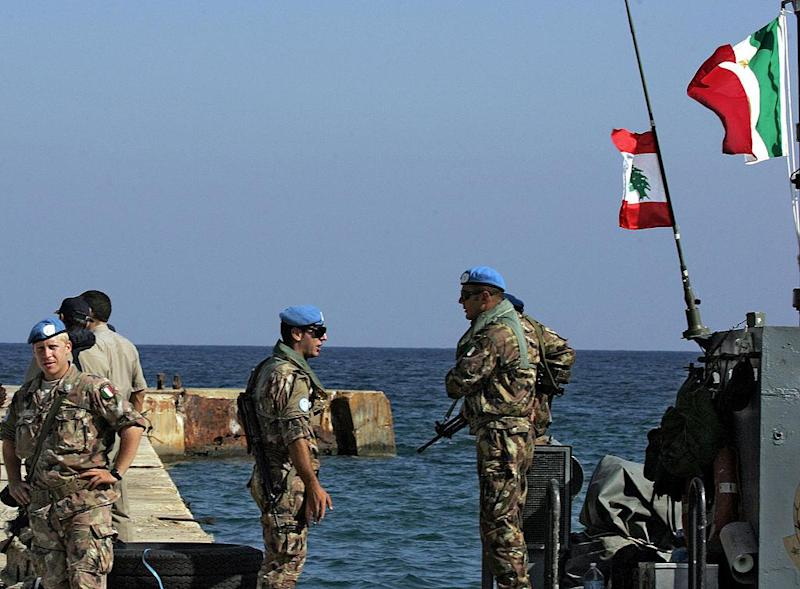 Italian troops from the United Nations Interim Force in Lebanon (UNIFIL) take position in the coastal Lebanese town of Naqura, on the border with Israel, in this file photo from 09 September 2006: AFP/Getty Images
