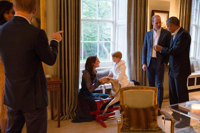 LONDON, ENGLAND - APRIL 22: In this handout provided by The White House, President Barack Obama talks with the Prince William, Duke of Cambridge as Catherine, Duchess of Cambridge plays with Prince George as First Lady Michelle Obama talks with Prince Henry at Kensington Palace on April 22, 2016 in London, England. The President and his wife are currently on a brief visit to the UK where they attended lunch with HM Queen Elizabeth II at Windsor Castle and later dinner with Prince William and his wife Catherine, Duchess of Cambridge at Kensington Palace. Mr Obama visited 10 Downing Street this afternoon and held a joint press conference with British Prime Minister David Cameron where he stated his case for the UK to remain inside the European Union.(Photo by Pete Souza/The White House via Getty Images)